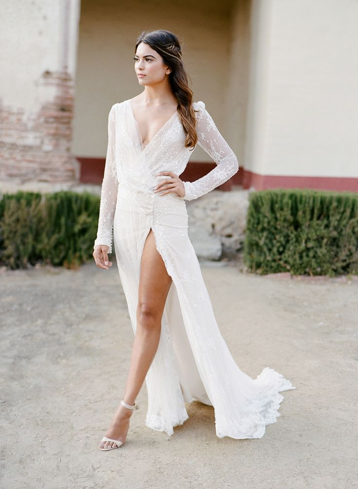 Seriously sexy high slit wedding dress: Styling + Design: Joy Proctor Design - www.joyproctor.com Wedding Dress: Inbal Dror - http://www.inbaldror.co.il/en Photography: Jose Villa Photography - josevillaphoto.com   Read More on SMP: http://www.stylemepretty.com/2016/07/19/stylish-california-elopement-inspiration/