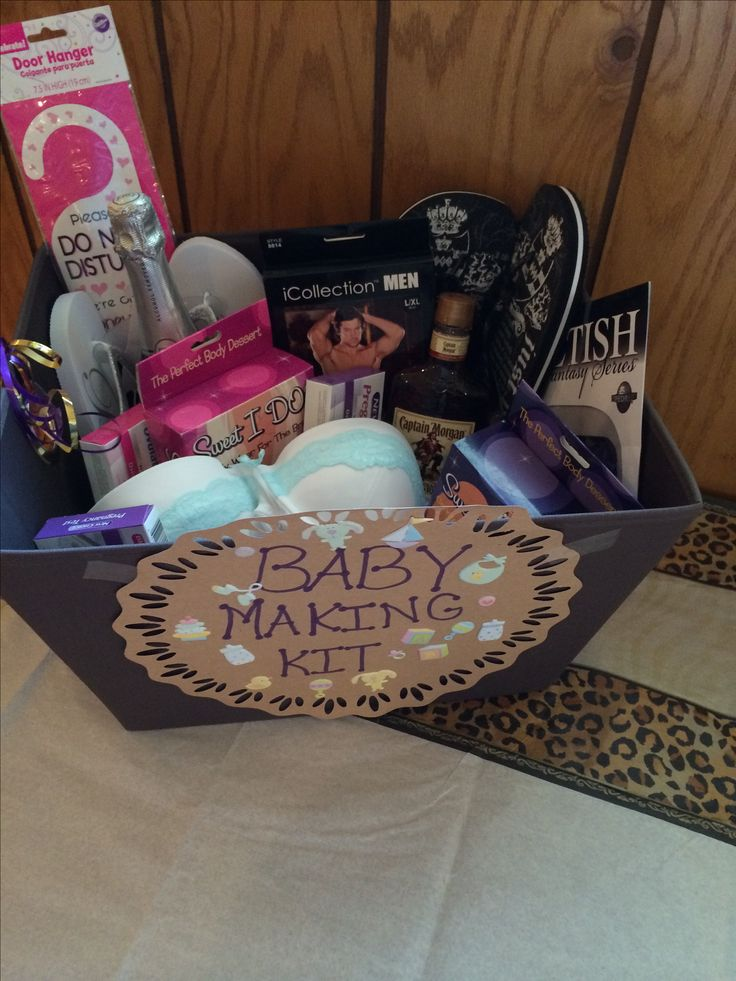 Baby makin kit for bridal shower gift  To get u started  I included a bottle of whiskey A blind fold and edible panties If ur feelin friskey I added some lingere For you&for Bryan  2 keep the mood going While you keep trying There's a pregnancy test For when aunt flow show up late  a bottle of nonalcholic wine To pop open&celebrate I also included some baby dust Sprinkling urself wit this is deff a must Sprinkle urself with this before you do the deed &it will help plant a babyseed