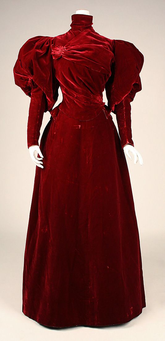 Red silk velvet evening dress (front, with high-necked velvet bodice with leg-o-mutton sleeves), by Charles Frederick Worth, French, 1893-95.