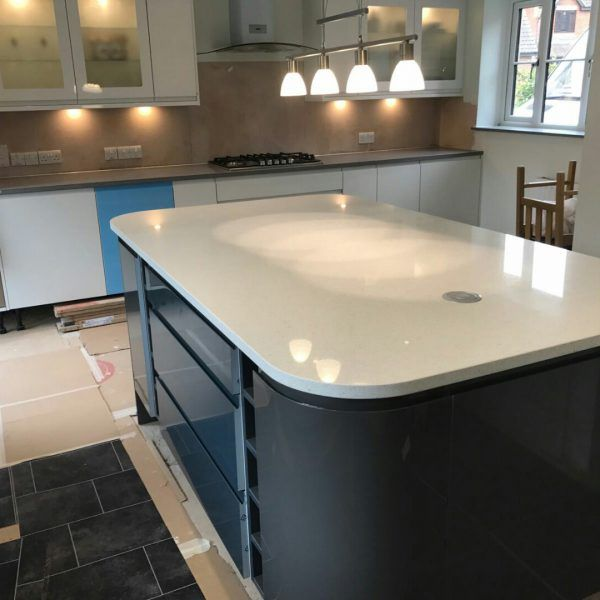 This is the Bianco Stella. It is a white quartz with very large mirrored speckles throughout. It is a very popular choice.