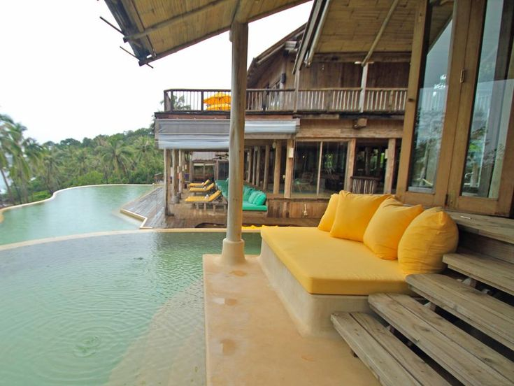 This tropical retreat features a dreamy infinity pool, extensive decking and cushioned seating to enjoy the view.