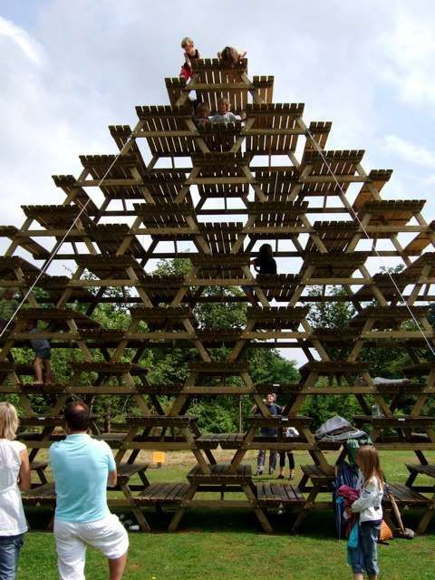 This massive triangular stack of wooden picnic tables is an art project/restaurant titled 'Rest' by Miguel Brugman and Martijn Engelbregt in Wageningen, Netherlands.