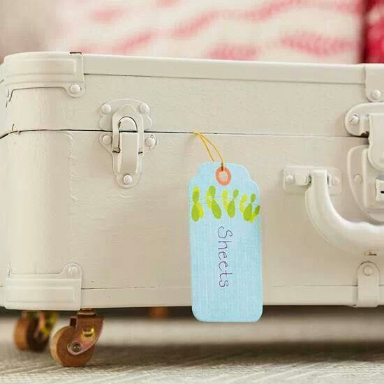 Add casters to old suitcases for under bed storage.