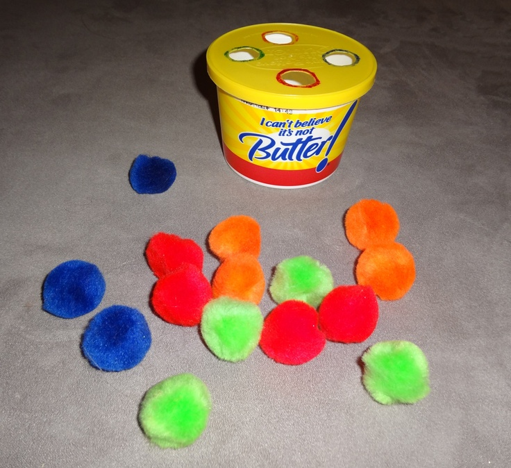 Pushing Puff Balls activity for toddlers
