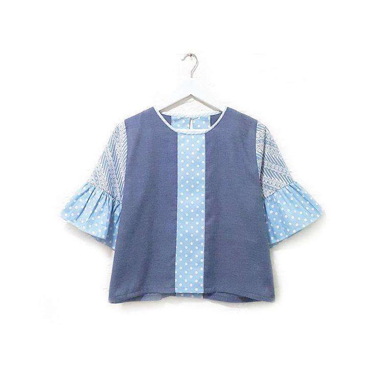Alyona 001  IDR 355.000   Casual Loose Fit Hand Stamped Batik Blouse with Ruffle Sleeve  Length of Blouse : approx. 51 cm  Length of Sleeve : approx. 31 cm  Material Used: Hand Stamped Batik, Cotton / Japanese Polkadot Fabric, Cotton / Japanese Linen Fabric  Free Size (Bust up to 102 cm)
