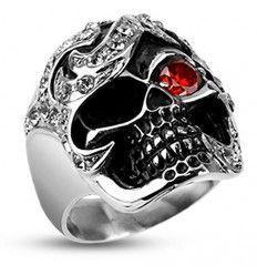bijou de doigt en acier chirurgical 316 L de qualité, représentant une bague tete de mort avec un zircon et un arbitre vide.