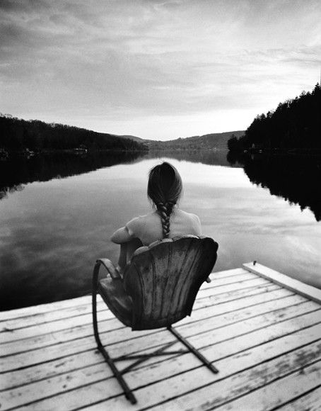 Tatiana sitting alone on the dock of a house called free on Bethel Island. Xo Edee