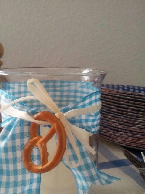 tie pretzel onto mason jar; scatter various sizes and types of pretzels on table for centerpiece decor.