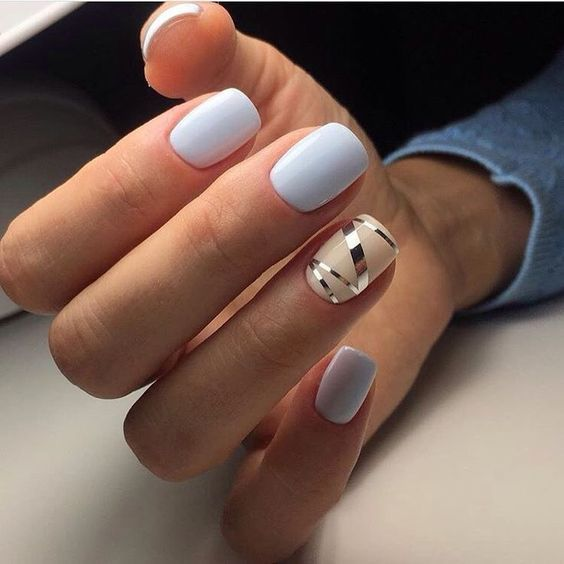 Pastel manicures with a touch of beige and a hint of gold.