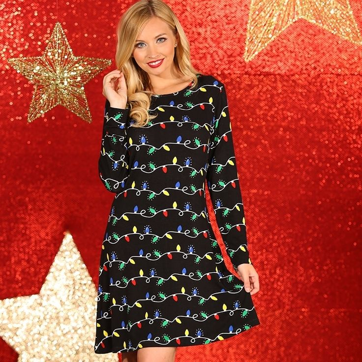 Dames kerstjurk met kerstlichtjes. Zwarte dames jurk met lichtjes opdruk. Een vrolijke, feestelijke en hippe skaterjurk in de huidige highstreet-trend. Materiaal: 95% viscose en 5% elastaan.