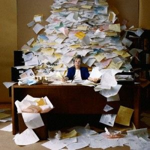 """Oh, no, those aren't ungraded papers from kids...that's all the paperwork, documentation, communications & other piles of papers teachers need to """"teach"""" today!  You can thank all those 3 & 4 letter acronyms like FIP, TBT, OTES, RTI, IEP, ESL, TAG, etc, etc, etc!  It all spells SOL for teachers!  No wonder most of them GET OUT within 10 years!"""