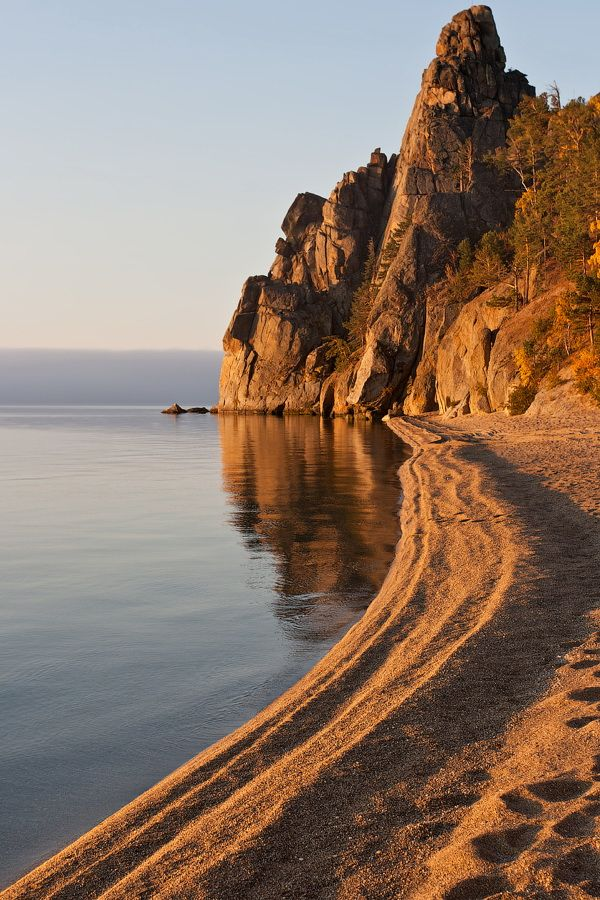 Lake Baikal, Russia. It is the most voluminous freshwater lake in the world, and the deepest. It is also among the clearest of all lakes, and thought to be the world's oldest lake. Baikal is home to more than 1,700 species of plants and animals, two thirds of which can be found nowhere else in the world!