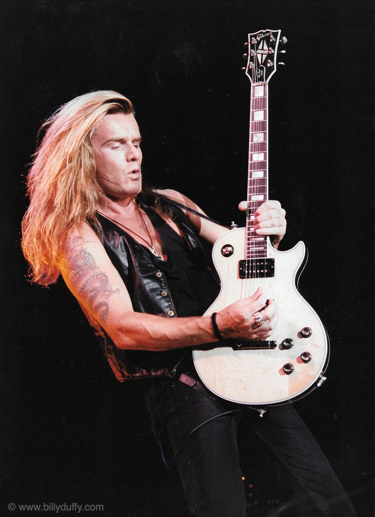 """Arena rock....and great hair..."" - Billy Duffy"