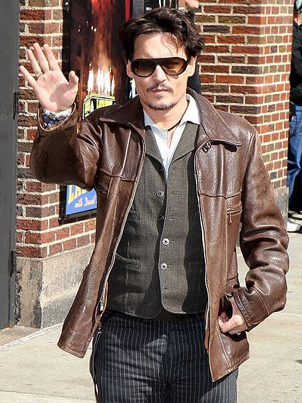 Johnny Depp waved to fans in the Big Apple in shady style! Gotta love his aviator-inspired shield sunnies!