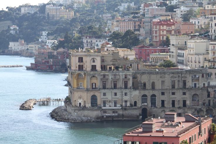 Palazzo Donn'Anna in Naples, Italy. It sits prominently at water's edge at the beginning of the Posillipo coast,