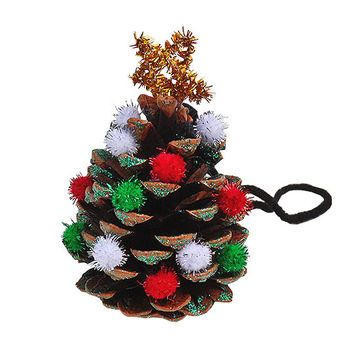 Transform a pine cone into a miniature tree.                 What You'll Need: pine cone, green glitter glue, small glittery pom-poms, yarn, 1 gold pipe cleaner, white craft glue                 Make It: Paint green glitter glue onto the edges of the pine cone and then use the glue to attach pom-poms in the crevices of the pine cone. Set aside to dry. Tie yarn into a 3-inch loop at the top of the pine cone and secure it down with glue. Bend the gold pipe cleaner into a small star and trim…