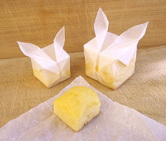 Parchment Bunny Cubes!: These little parchment bunnies are the cutest alternative for running out of cupcake/baking tins.  Just fold up these cute little packages and your baked goods are one step closer to delivery!