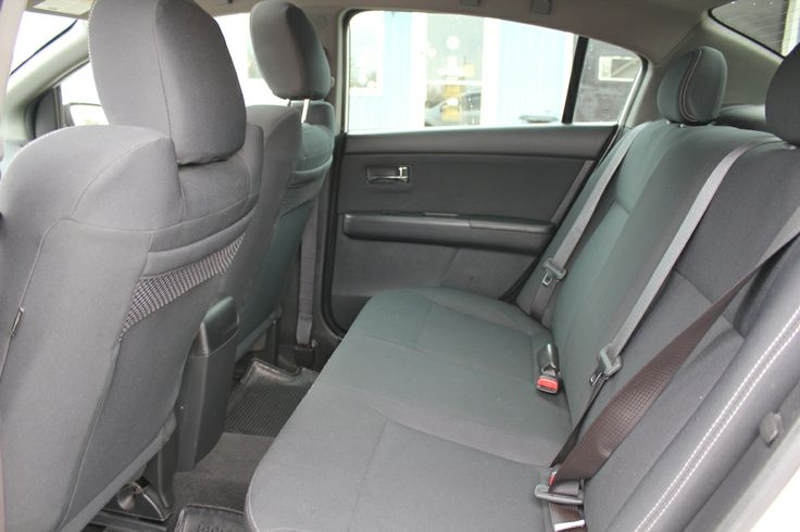 The sport fabric seats are grippy and include red contrast stitching and SE-R logos knitted in the seatbacks, which adds a little more excitement to the cabin. No other compact sedan beats the Sentra in interior volume, and back-seat occupants benefit from a large bench.