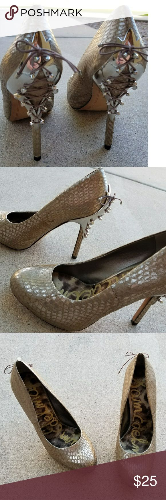 "4"" Sam Edelman Gold Faux Snakeskin Heels These shoes are so hot! The studed lace up back is such a sexy detail, the shoe is a gold faux snakeskin print. 70% off price from Nordstrom Rack is $51 Sam Edelman Shoes Heels"