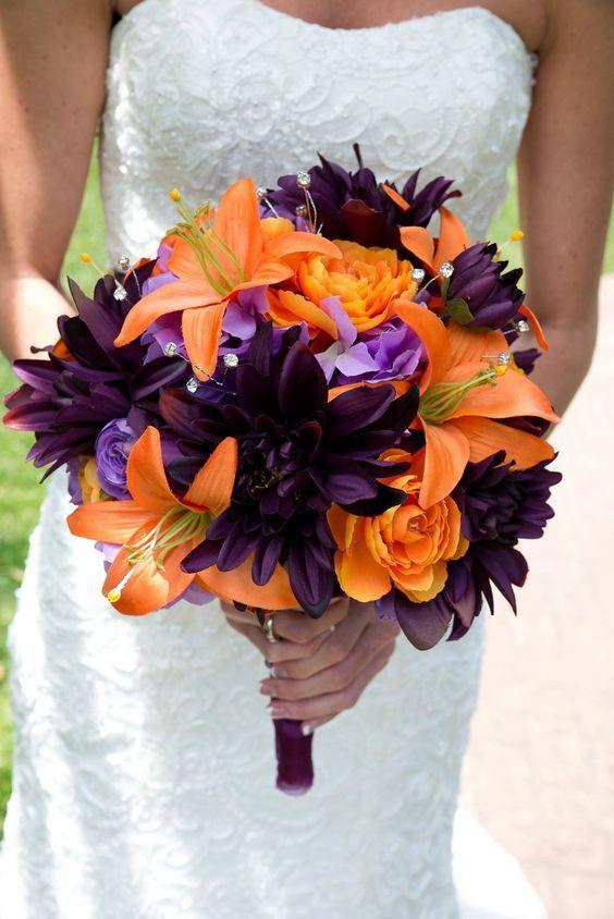 Orange and Plum purple wedding bouquet.  With diamonds. Orange lily and plum dahlia.
