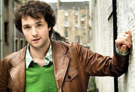 LOUIS  (Chris Addison)