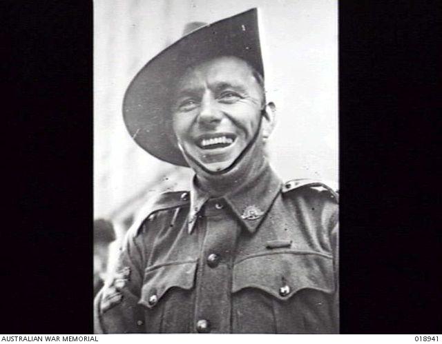 Sydney, NSW. August 1945. Portrait of Sergeant Reginald Roy Rattey, an Australian VC winner, who was mobbed when he appeared at an Australian Comfort's Fund rally in Martin Place. 018941 | Australian War Memorial