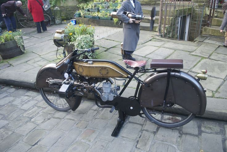 """mymotorcycle: """"In Haworth this weekend just gone, I happened upon a Steampunk event. Someone had """"Steampunked"""" this old style motorbike.Dot worry, the machine gun isn't real, its a Nerf toy. """""""