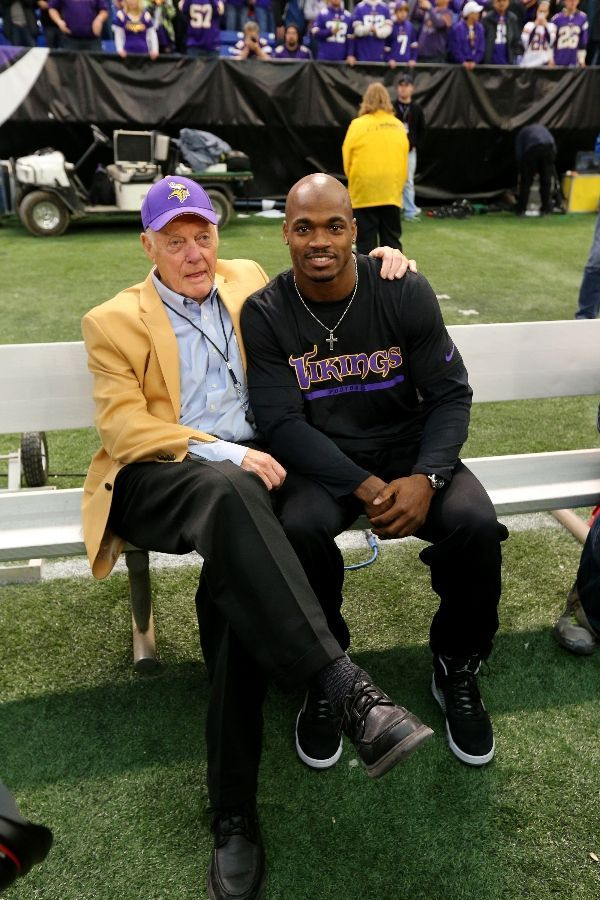 Minnesota Vikings Team Photos - Bud Grant and Adrian Peterson.