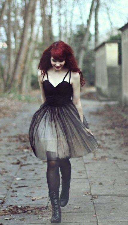 Goth scenes in the winter when all is gray. Black on black/white with red hair and lips. Looking down.