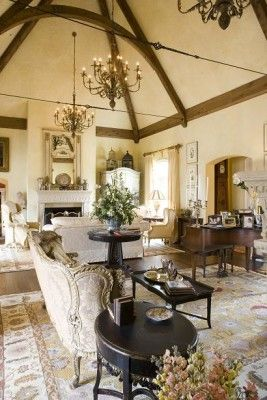 French Country style... love the truss ceiling with iron tension rod...
