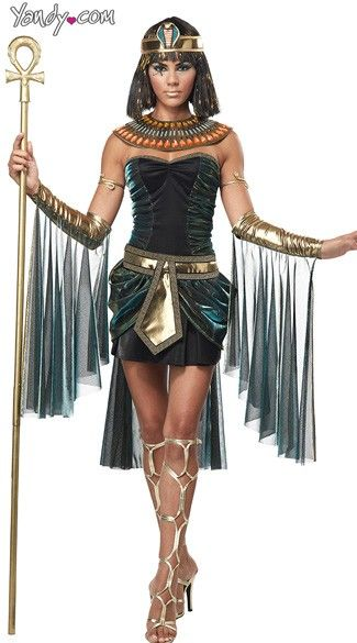 The Egyptian Goddess costume includes a teal and black, ruched side tube dress with peplum detail, metallic gold belt, long mesh train,  metallic gold sleeves with long mesh details, collar and head piece. (Wig, snake arm cuffs, and staff not included.).