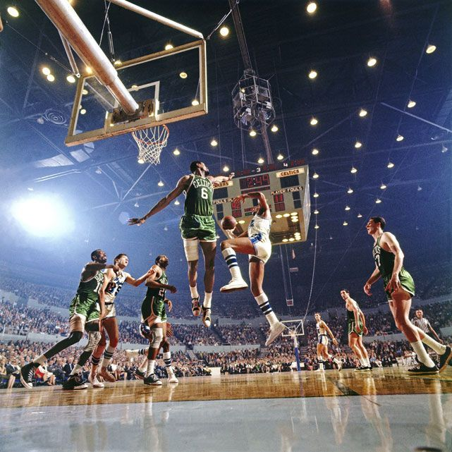 Bill Russell guards the lane against an Elgin Baylor drive during Game 4 of the 1966 NBA Finals between the Lakers and Celtics. Boston would go onto win the title in seven games, capturing their eighth straight championship and ninth in franchise history. (Walter Iooss Jr./SI)  GALLERY: Rare Photos of Bill Russell| Iconic Lakers | Iconic CelticsSI VAULT: Bill Russell wanted, and got, a new pair of shoes (4.11.66) Get the best tips on how to increase your vertical jump here: