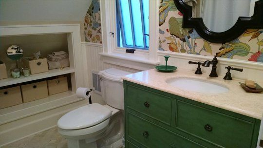 """Before & After: Marissa's New """"Old"""" Bathroom...love that wallpaper, really looks great with the green cabinet."""