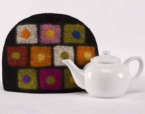 Fair Trade Felted Wool Tea Cozy- Teapot Not Included (Black) by Fibres of Life. $33.95. These are made in a fair trade women's cooperative in Nepal.. The felted wool really holds the heat so you won't be running to the microwave.. wool. These cozies have a modern muted, rich earthy feel.. It fits most 4 to 6 cup teapots.. The felted wool really holds the heat so you won't be running to the microwave. Hand wash in lukewarm water agitating occasionally, lay flat to dry.