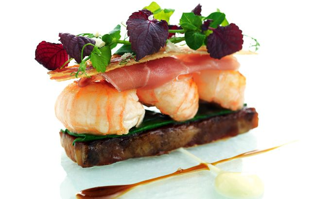 Seared langoustine tails with caramelised bacon, apple and vanilla purée, Brazil nuts and pancetta