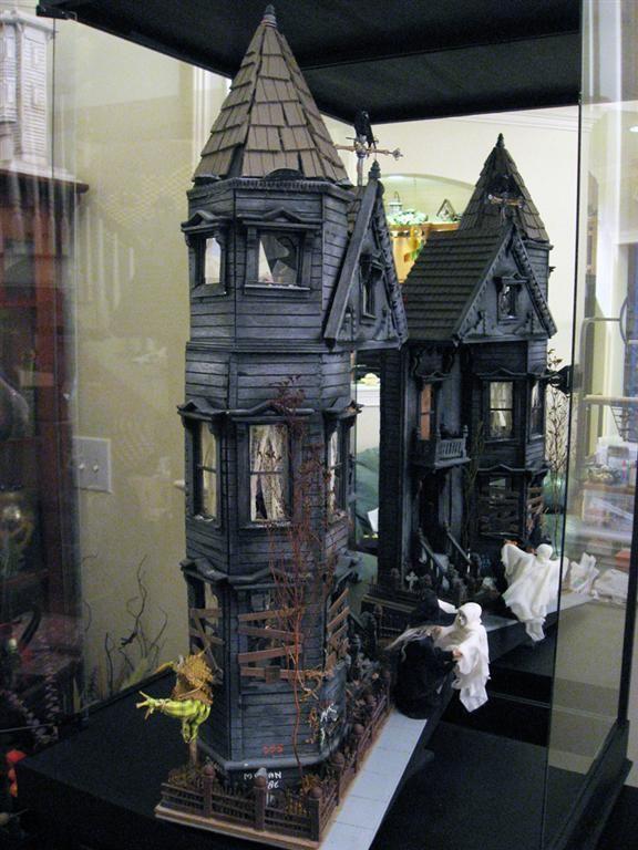 Awesomeness from http://www.dollshouseblog.com/2011/11/24/haunted-dolls-house-is-weird-and-wacky-winner/