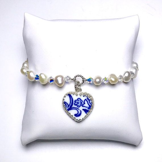 Broken China Jewelry Bracelet, Blue and White Jewelry, Pearl Bridal Bracelet, Vintage Wedding, Blue Wedding, Flow Blue China ~ Creamy white freshwater pearls, charming nugget shape, all a little bit different. ~ Antique flow blue china violet pattern. ~ Sterling Silver ~ Swarovski crystals ~ Heart setting measures 3/4 x 3/4. ~ Fits small to medium wrist ~ Convo me for custom color combos and multiples made specially for you! Wear a piece of the past with DinnerWear Jewelry! ...