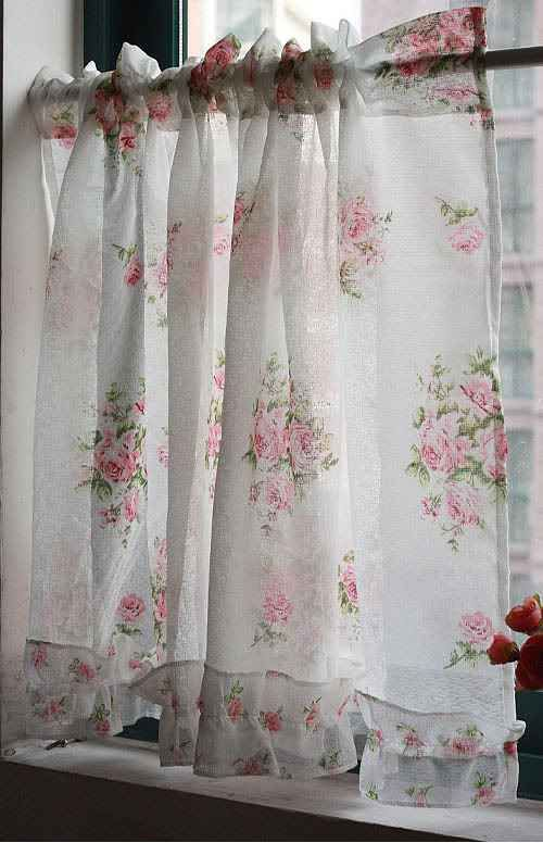 sweet rose curtains made from vintage fabric. You won't find these in a catalog! :)