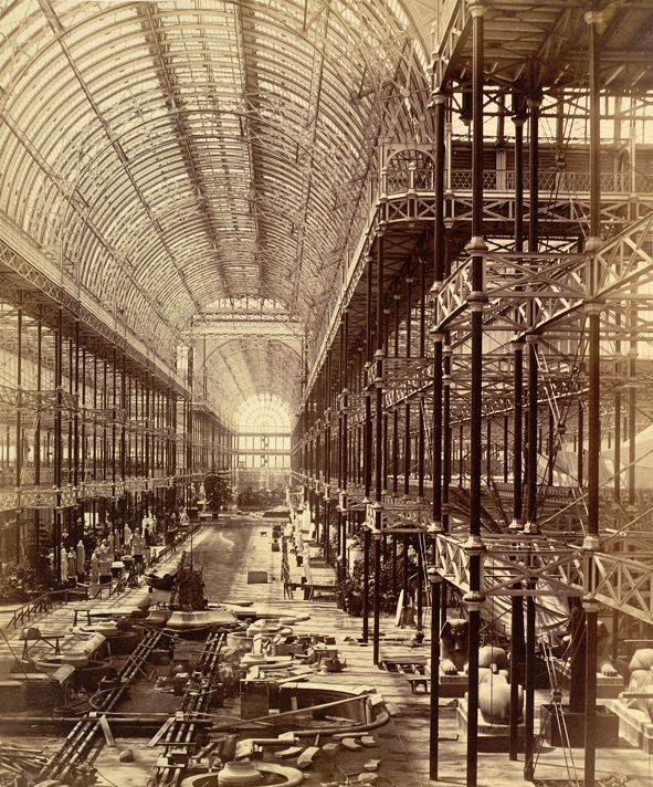 Construction work in progress at the nave of the Crystal Palace exhibition hall in Sydenham. The Nave From The North End, Commencement Of Monti's Fountain. Image via the British Library.