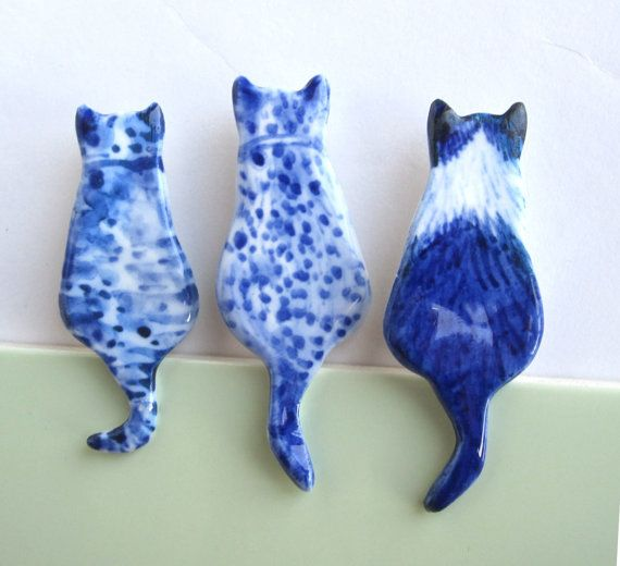 Love these Handpainted Delft porcelain Cat brooches by Harriet Damave