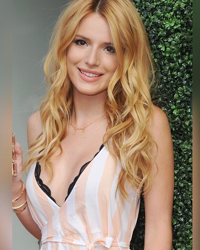 (FC: Bella Thorne) Hey, I'm Alicia Bjorgman, daughter of Anna and Kristoff. My hair used to be like Mom's, but it's starting to become blonde.
