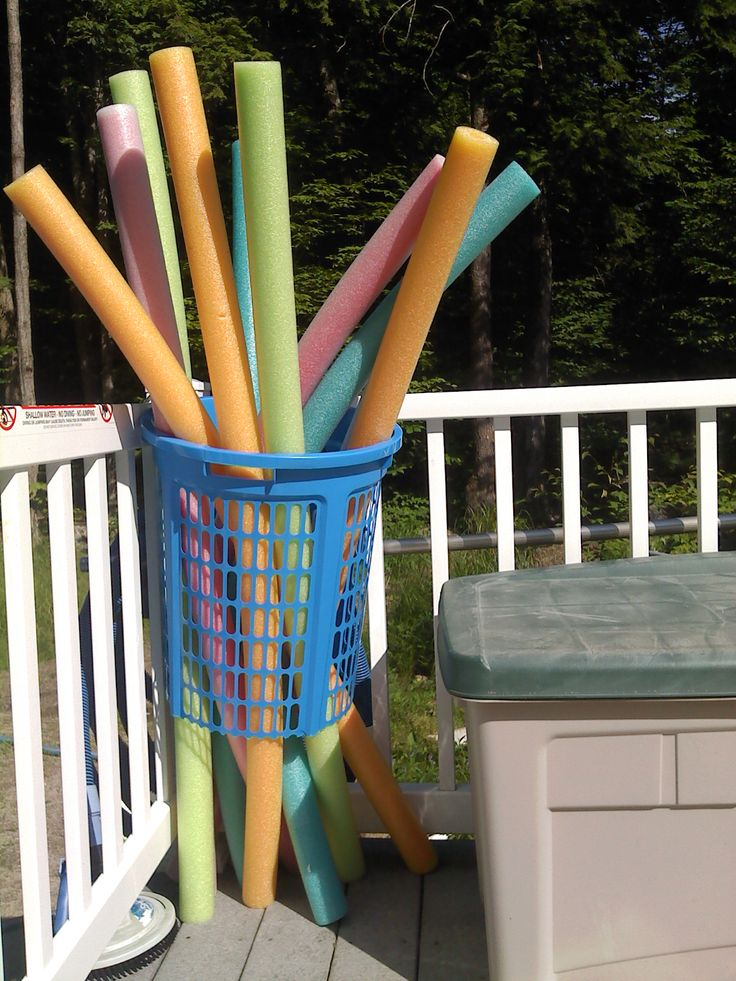 """Pool clutter management idea - an inexpensive """"hamper"""" with the bottom cut out keeps those Noodles under control!"""