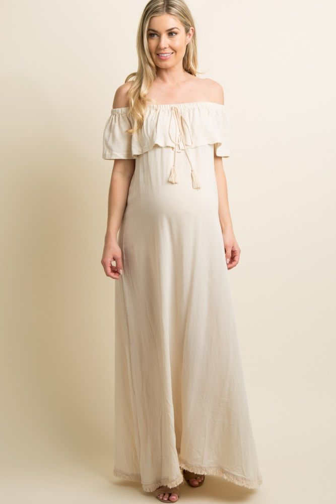 b80b319bb51 A solid hued linen maternity maxi dress featuring a cinched off shoulder  neckline with a slit front ruffle trim and a tassel tie accent.