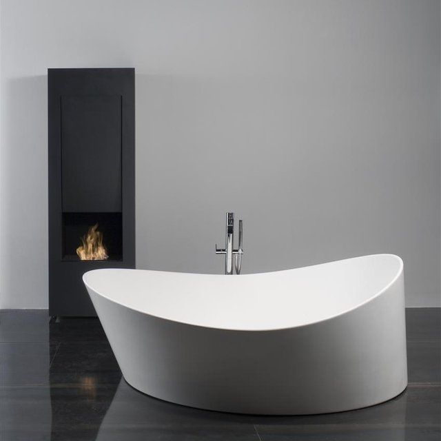 Dune Bathtub by Mario Ferrarini for Antonio Lupi-- only one thing to be improved here, it needs a BIGGER FAUCET!!! otherwise you'll be sitting in cold water by the time bathtub water is high.