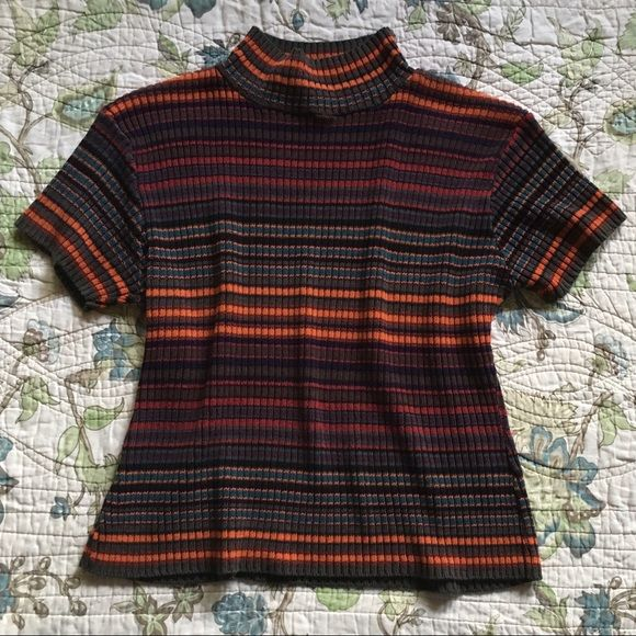 "Vintage 90s grunge striped sweater shirt Vintage 90s grunge orange, red, teal, burgundy and brown striped mock neck sweater shirt. Short sleeved knit sweater shirt. Has a mock neck. Has good stretch. Measurements are taken laying flat: armpit to armpit: 19.5"" length: 20"" Vintage Tops"