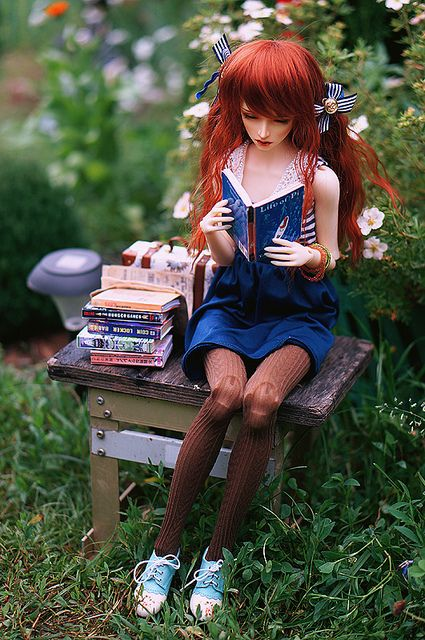 reading in the garden by AzureFantoccini on Flickr.