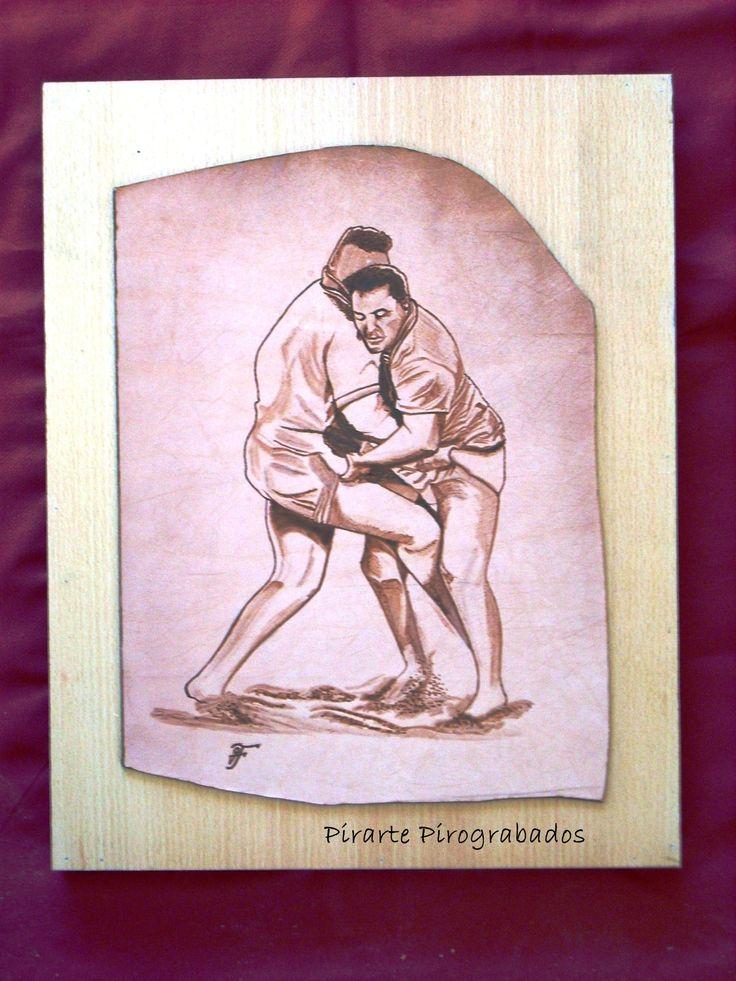 Lucha canaria pirograbada sobre piel y montada sobre madera