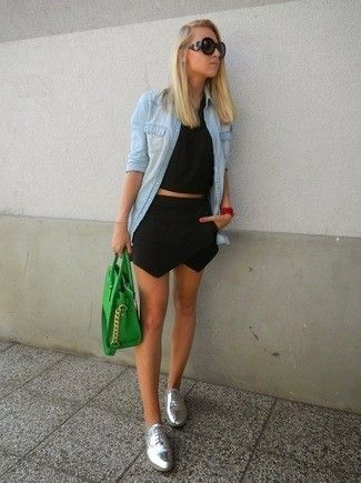 Women's Black Sunglasses, Light Blue Denim Shirt, Black Cropped Top, Black Mini Skirt, Green Leather Tote Bag, and Silver Leather Oxford Shoes