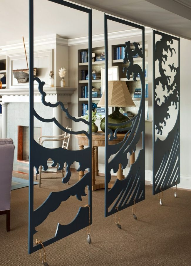 fabulous room divider; also, check out that cool 3D art above the mantel. House Tour: Ocean House
