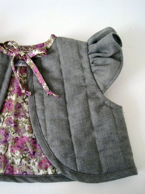 Loving this vest! Love the little ruffle sleeve